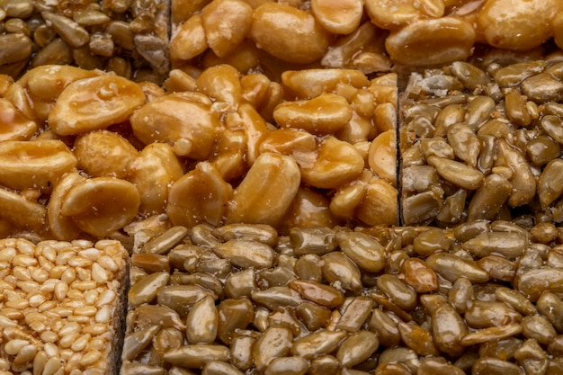 Close up view of honey bars with peanuts sesame and sunflower seeds