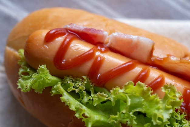 Close up view of hot dog bacon