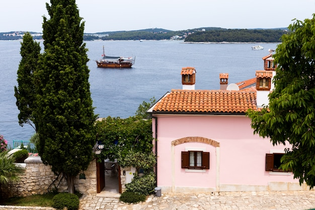 Close-up view of houses with tiled roofs and the sea in the european old town of rovinj, croatia.