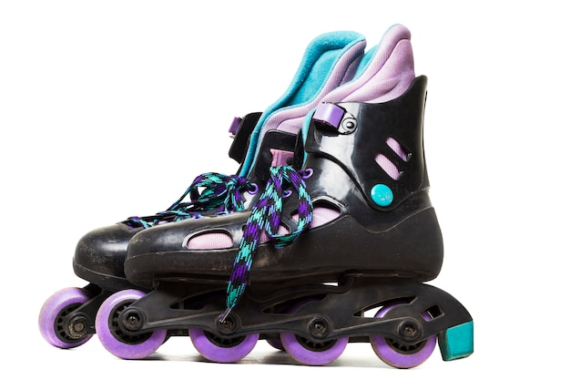 Close up view of inline skates isolated on a white background.