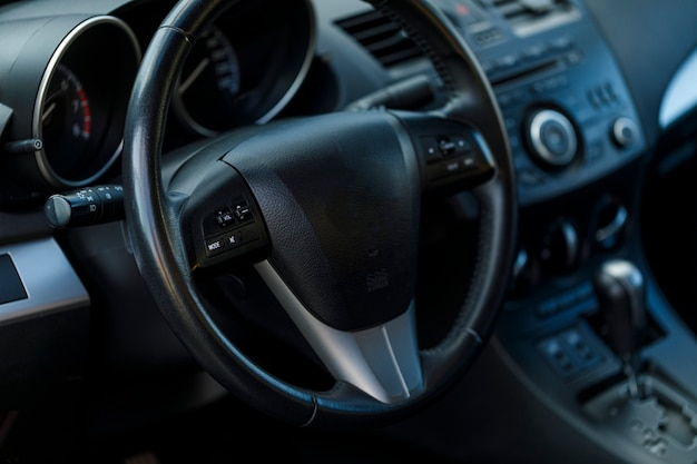 Close up view of the interior of a modern automobile showing the dashboard.
