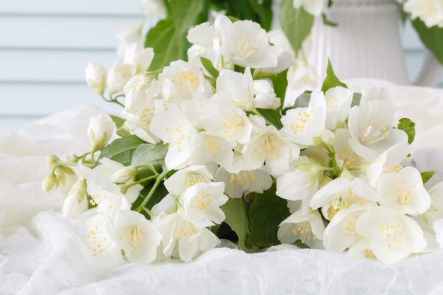 Close up view of jasmin flowers lay on table