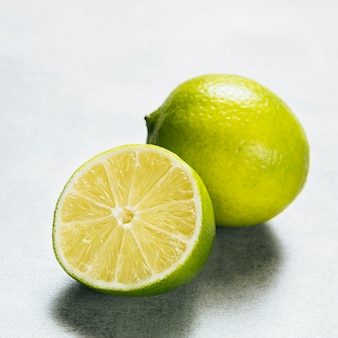 Close up view of lime on plain background