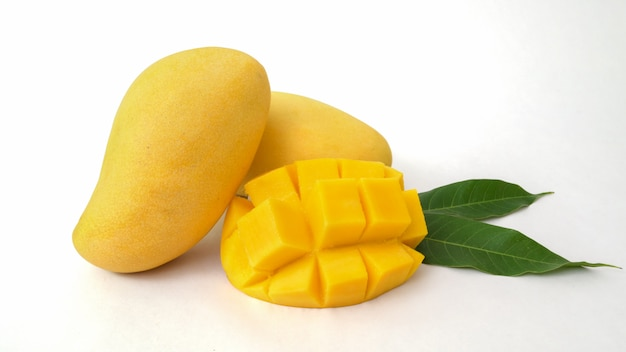 Close up view of mangoes fruit and mango cut in cubes isolated
