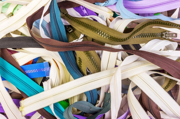 Close-up view of many colorful zippers. multicolored zippers background