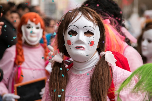 Close up view of masked women in a carnival parade.