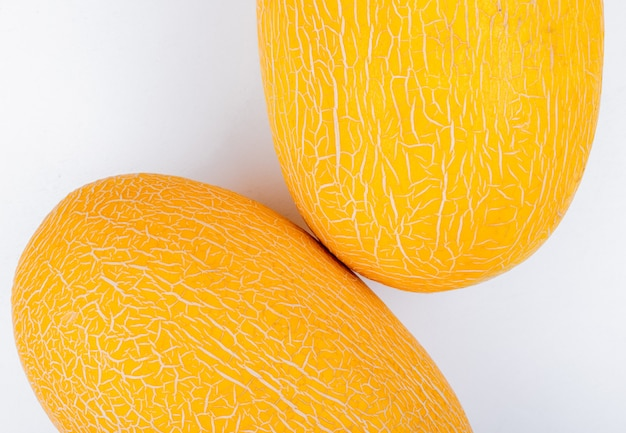 Close-up view of melons on white background