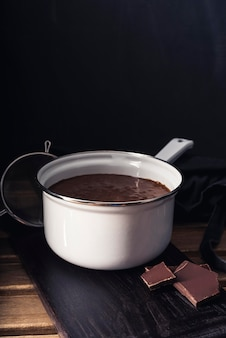 Close-up view of melted chocolate in pot