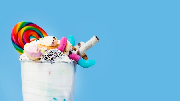 Close-up view of milkshake on blue background with copy-space