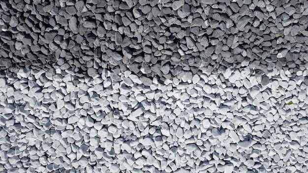 Close up view of mixed grey gravel and slate gray stones background