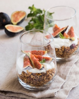 Close-up view of muesli with figs in glass