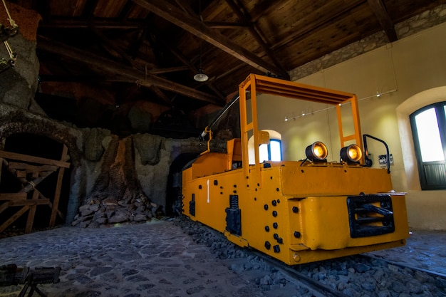 Close up view of a museum with an old transport mining vehicle.