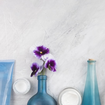Close-up view of natural body cosmetics on marble background