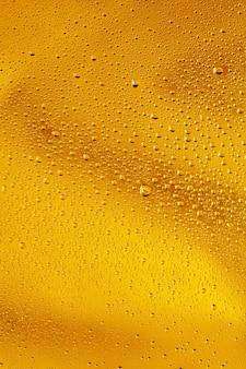 Крупным планом вид холодных капель на стакан пива фон текстура охлаждения алкоголя