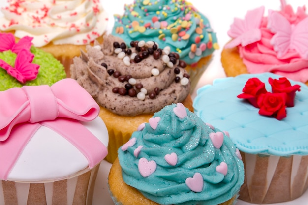 Close up view of original and creative cupcake designs isolated on a white background.