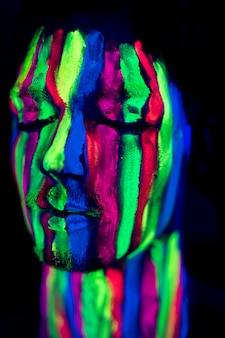 Close-up view of person with fluorescent make-up