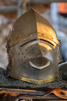 Close up view of a pigface bascinet helmet.