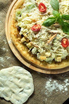 Close up view of pizza caesar on rustic