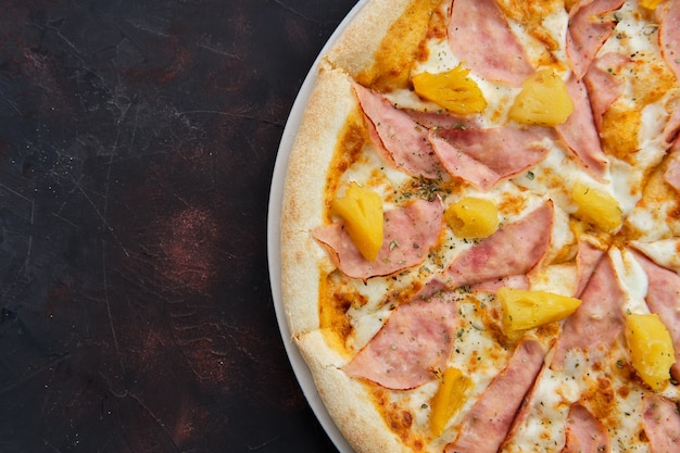 Close up view of pizza with chicken ham and pineapple
