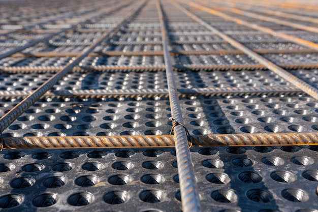 Close up view of reinforcement of concrete geometric alignment of rebars on construction site