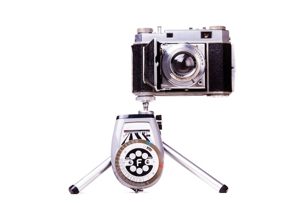 Close up view of a retro vintage photographic camera isolated on a white background.
