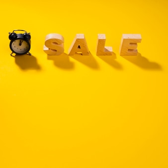 Close-up view of sale word on yellow background