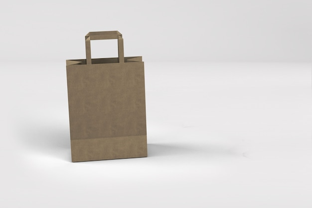 Close up view of shopping bag from craft paper with handles on white