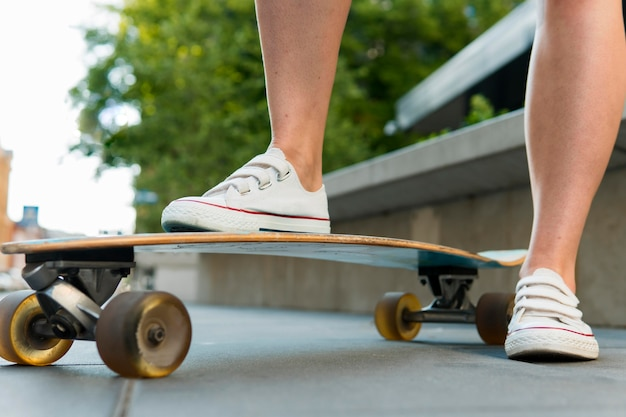 Close-up view of skateboard in urban city