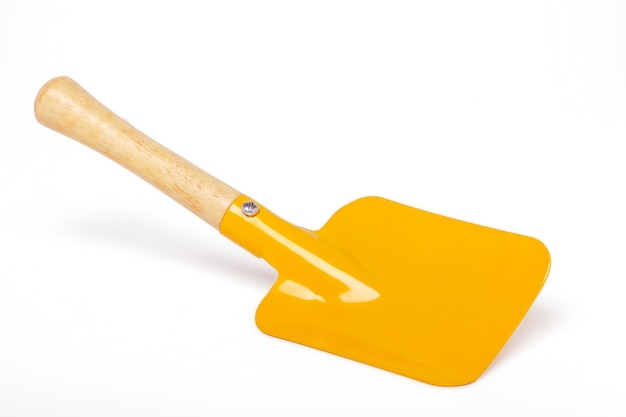 Close up view of a small gardening shovel isolated on a white background.