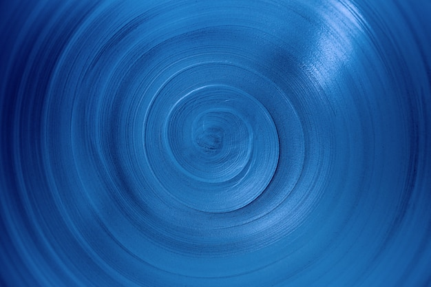 Close-up view spiral lines of trendy phantom blue color, abstract background of infinity with copy space