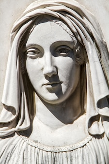 Close up view of a statue from a tomb in the famous portuguese cemetery prazeres in lisbon, portugal.