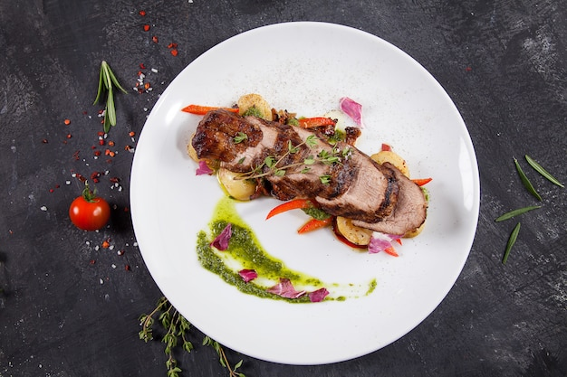 Close up view on tasty grilled and roasted beef with potato, forest mushroom on white plate. restaurant food for lunch.