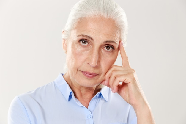 Close-up view of thinking old lady