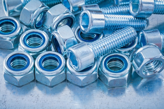 Close up view of threaded construction nuts and screw bolts on m