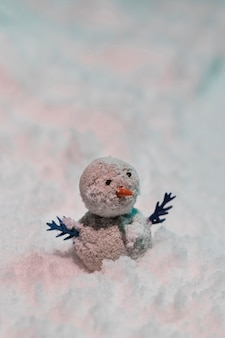 Close-up view of tiny snowman  on snow