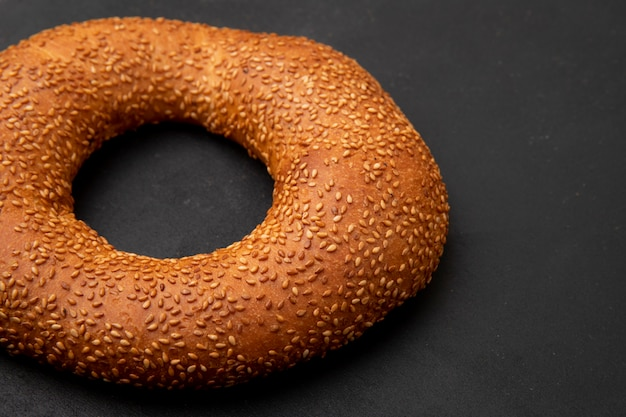 Close-up view of turkish bagel on black background with copy space