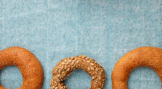 Close-up view of turkish bagels on blue background with copy space