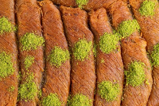 Close up view of turkish dessert burma kadayif with pistachio nuts