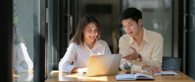 Close up view of two university students consulting on their assignment