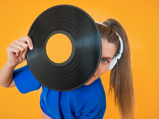 Close-up view of vinyl and woman