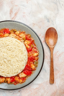 Close up view of white plain rice meal with chicken and tomato sauce