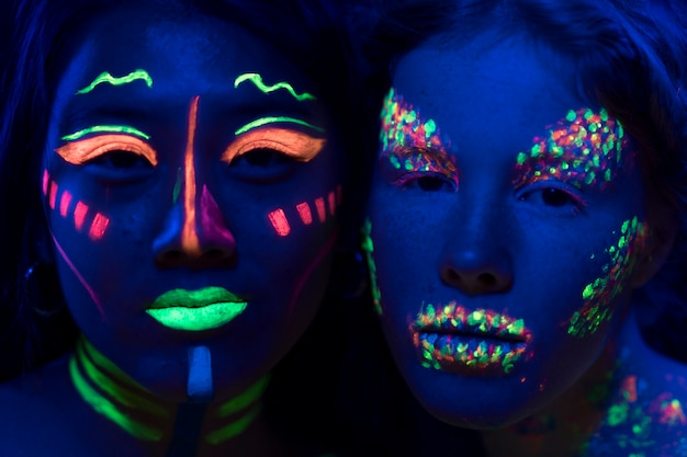 Close-up view of women with fluorescent make-up