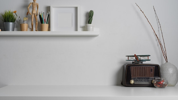Close up view of worktable with copy space and decorations in white concept in home office room
