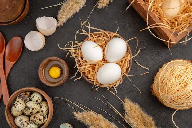 Close up view of yellow chaws in a wooden box rope spikes eggs on black background