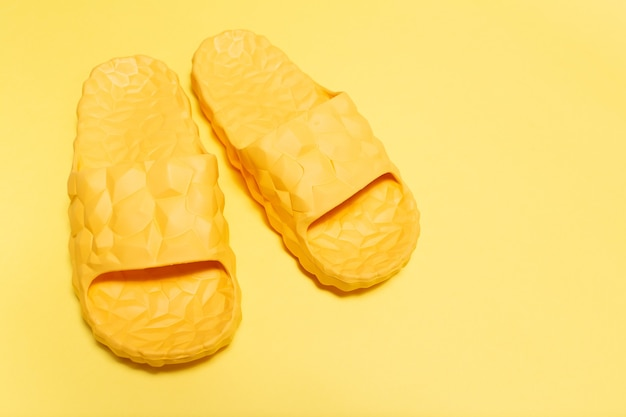 Close-up view of yellow slippers