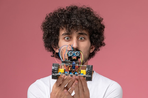 Close up view young man surprising by new innovation