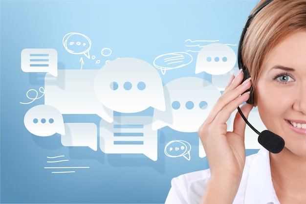 Close-up view of young woman face with headphones, call center or support concept