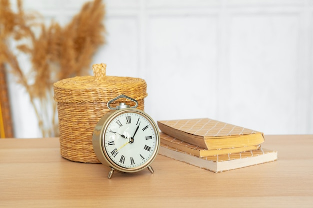 Close up of vintage alarm clock on wooden table