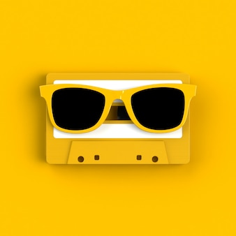 Close up of vintage audio tape cassette with glasses
