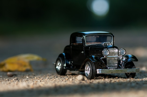 Close-up on a vintage car on a road in a forest. childhood memories.